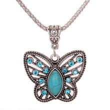 Farfi Women Retro Turquoise Butterfly Hollow Rhinestone Inlay Pendant Tibetan Necklace as the pictures